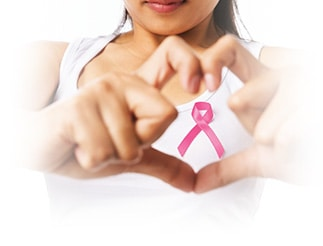 A lady is framing the breast cancer awareness symbol